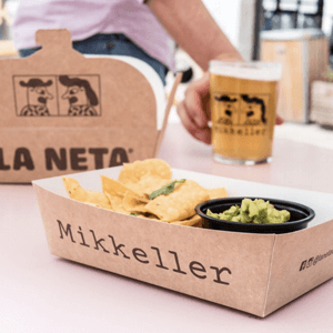Tacos tray made of brown Kraft paper with the black Mikkeller logo.