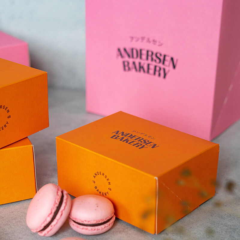 Multi-colored pastries boxes with the Andersen Bakery logo.