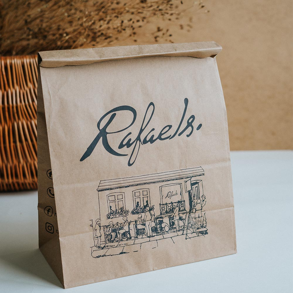 A kraft paper take-away bag with a black print is a new trend in the packaging industry