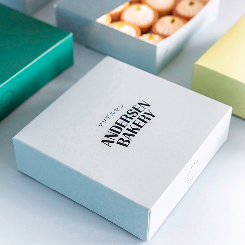 Different-colored paper packaging for pastries, distinguishes Andersen Bakery from the competition.