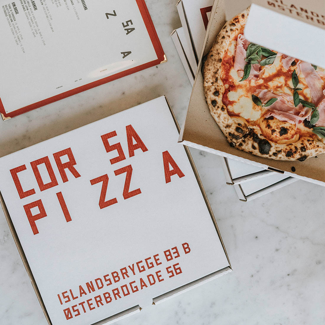 For Corsa Pizza we have produced white pizza boxes with a characteristic red print.