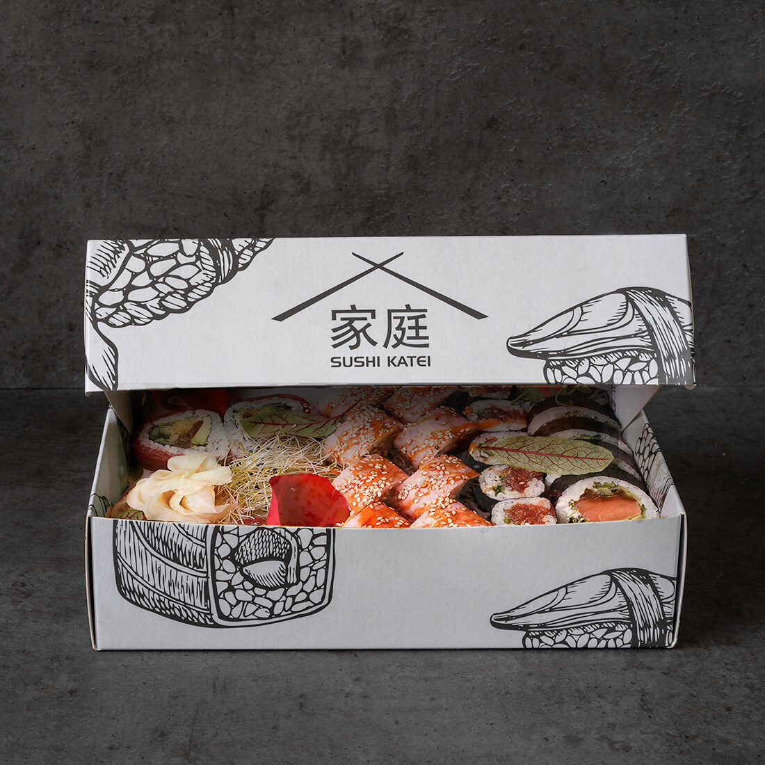 Paper sushi boxes with an original print for Sushi Katei restaurants effectively set them apart from the competition