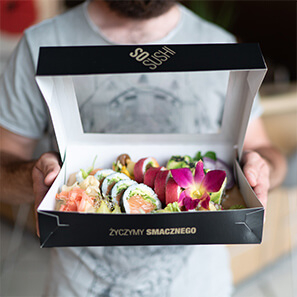 Elegant, black sushi box with window. Print with the So Sushi company logo and golden slogan.